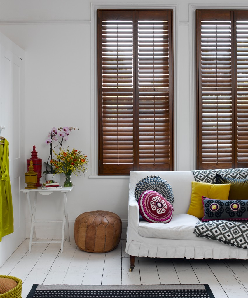 Dark wood shutters, wooden shutters, tribal bedroom, boho bedroom, colourful bedroom, patterned cushions, Pippa Jameson, Pippa Jameson Stylist, California Shutter Company