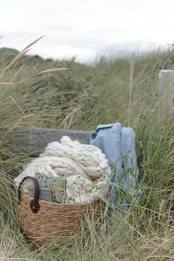 Beach styling showing reclaimed apple crates, cable knit throws and reclaimed wooden stools. Styling Pippa Jameson, Photos Jo Henderson