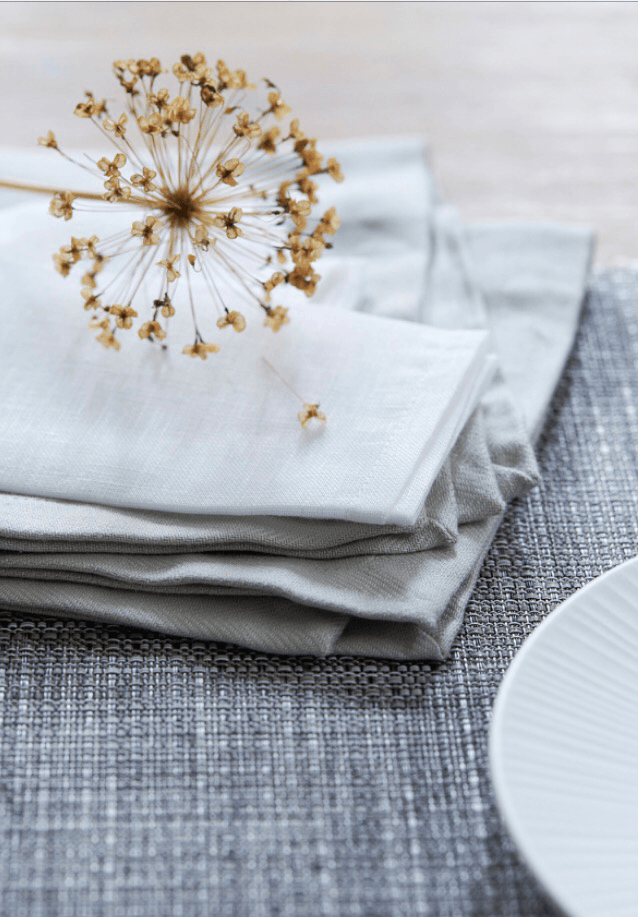 natural napkins, grey textiles, dried alliums, Layer up your Monochrome and Ikat chinaware for a calm and contemporary dining room, Brent Darby, Pippa Jameson Interiors