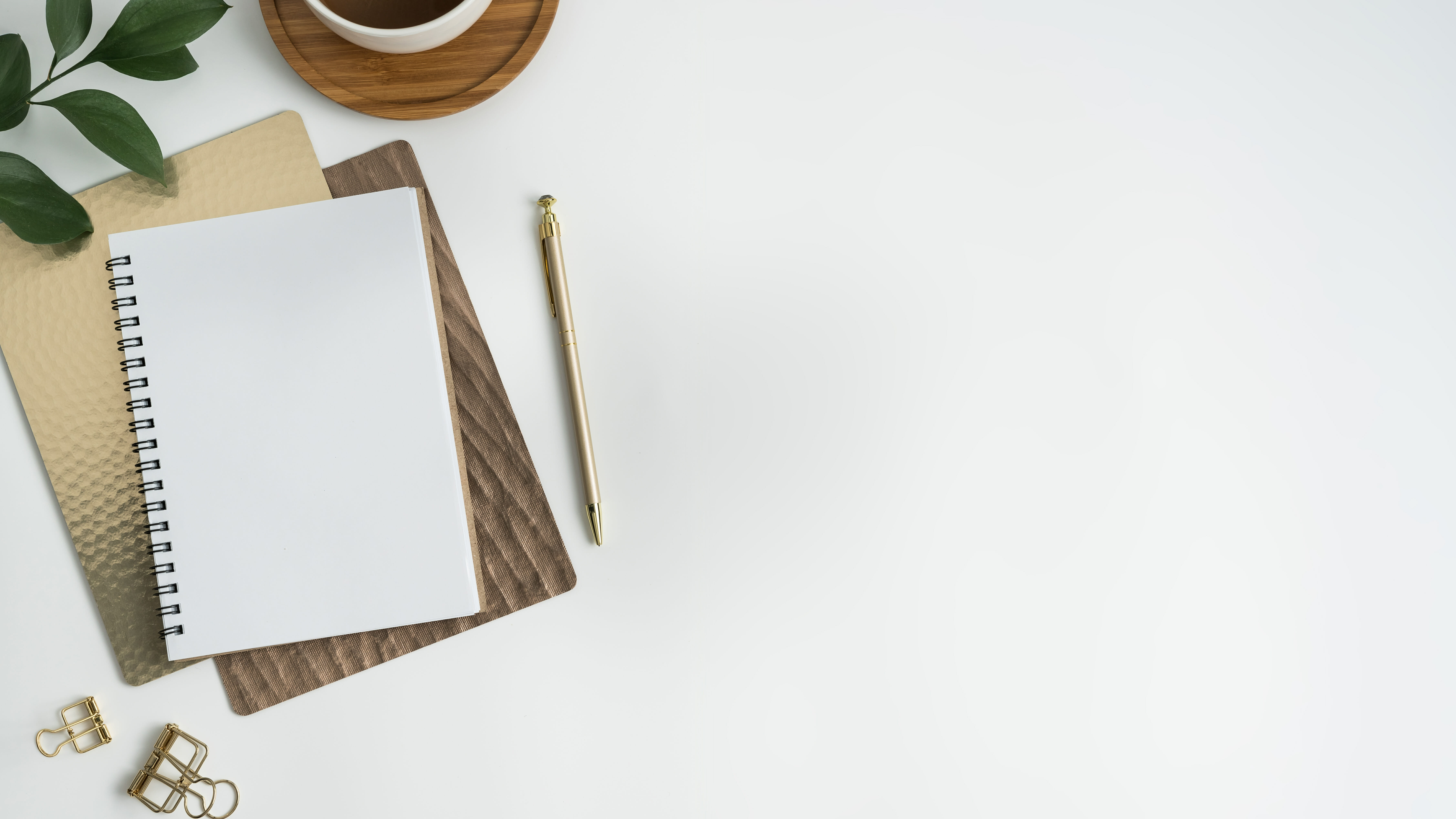How to write an email pitch: notebook and pen on desk