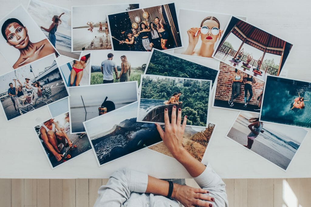 How to become a stylist: person looking at lots of printed photos
