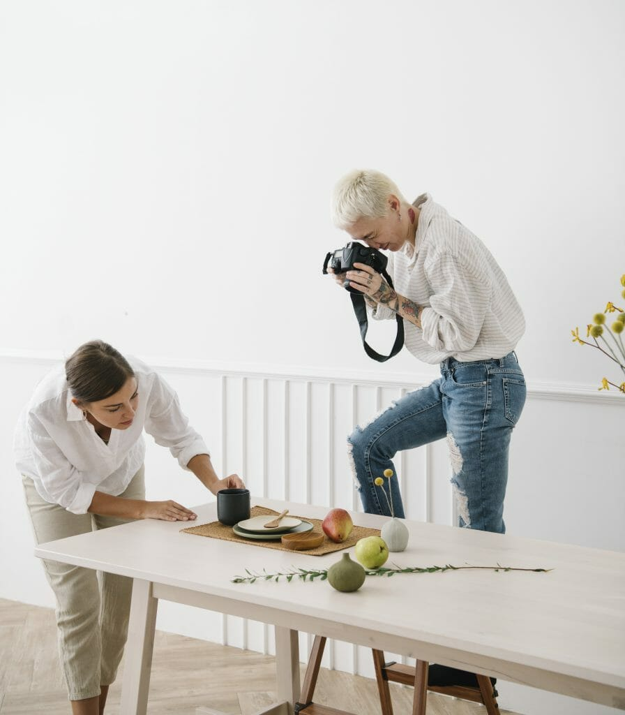 people styling flatlay and taking photo
