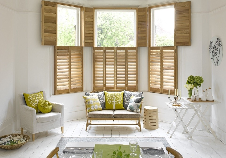 Scandinavian living room, wooden shutters, Pippa Jameson, light wood shutters, white floorboards, green and white living room