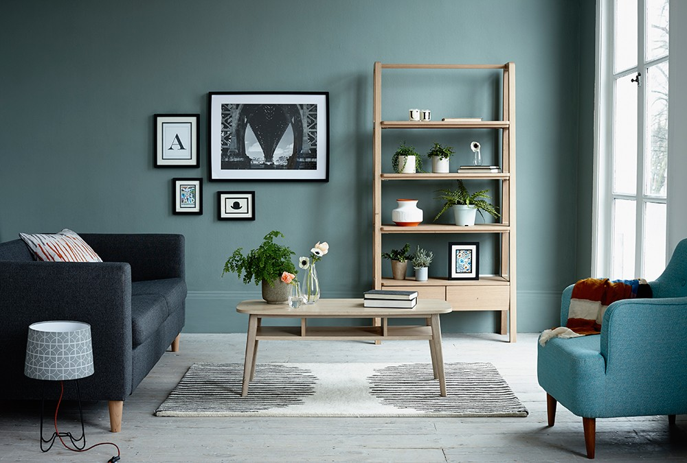 Scandi style furniture against a deep green Farrow & Ball wall. Next homeware styled by Pippa Jameson and photographed by Jo Henderson.