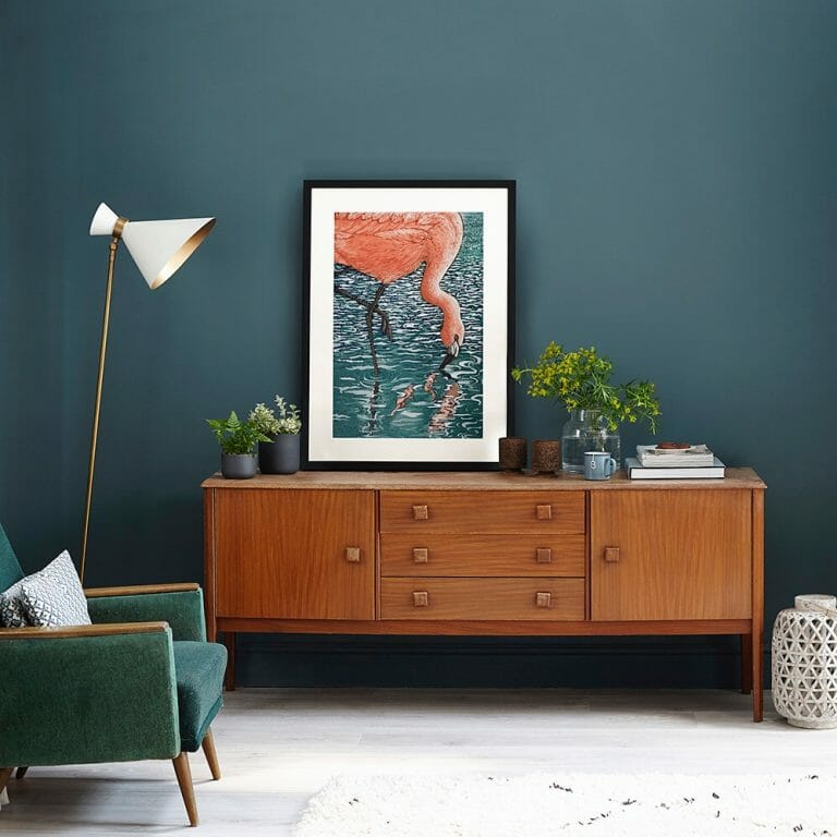 How to become a stylist: armchair and sideboard with artwork and plants