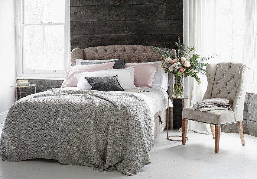 Bedroom styled by Pippa Jameson and photographed by Jo Henderson.  Pale pinks and greys, with wood clad walls for Next home