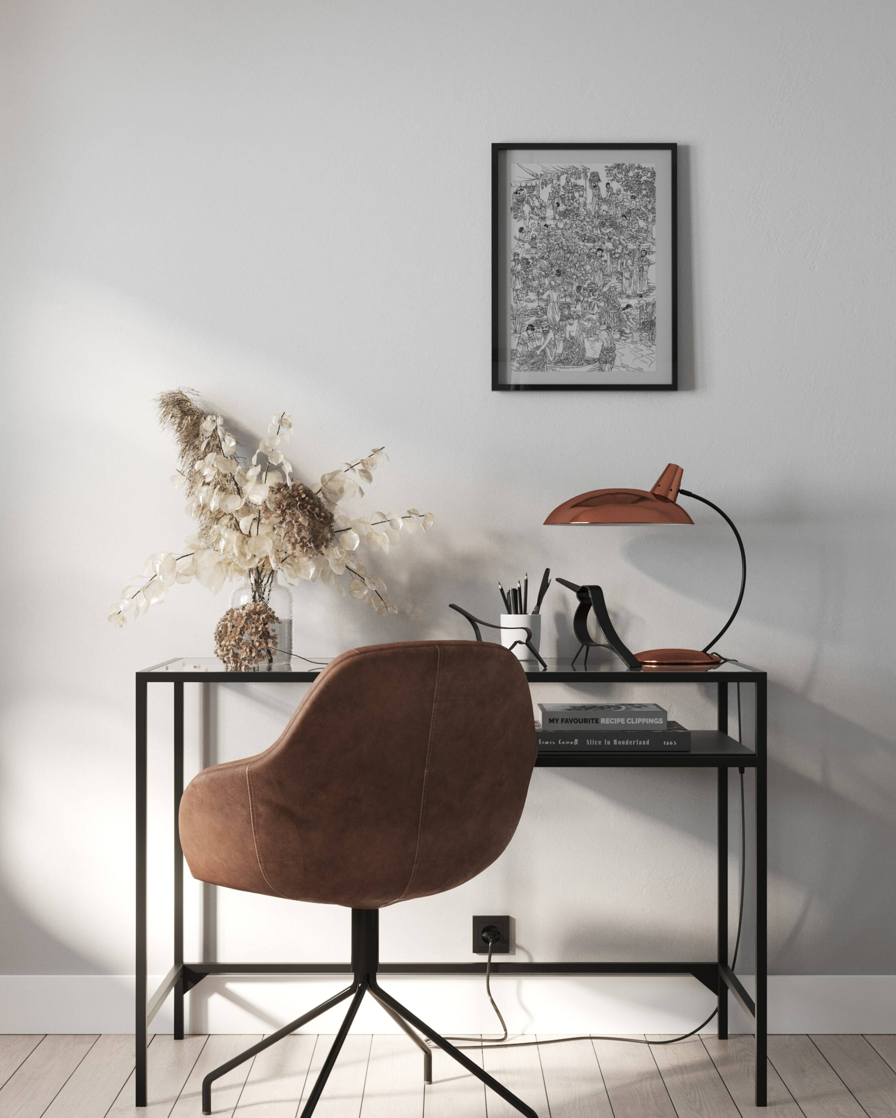 Running a creative business: desk set up with lamp, flowers and wall art